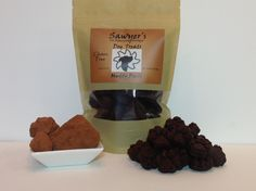 Muddy Paws These treats are perfect for spoiling your pet!  Made with carob instead of chocolate, your dog will think he's getting away with eating chocolate. Available in 8oz bag of paw prints for $15 +tax. Made with brown rice flour, coconut milk, honey, safflower oil, egg, carob powder, vitamin e oil, baking powder, and baking soda.