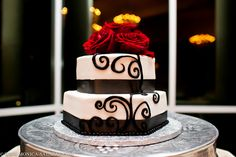 wedding cake, red roses, black and white cake, scroll design