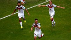 Mats Hummels of Germany (C) celebrates with teammates Sami Khedira (L) and Benedikt Hoewedes (R) after scoring his team's second goal during the 2014 FIFA World Cup Brazil Group G match between Germany and Portugal at Arena Fonte Nova on June 16, 2014 in Salvador, Brazil