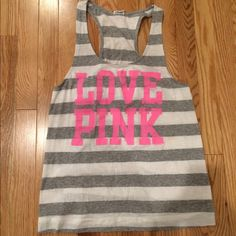 VICTORIAS SECRET PINK racerback tank Size small. Could fit a size medium. Gray & white stripes with neon pink writing. Worn couple times, still in great condition. No stains or imperfections. Smoke free home. Offers and trades are welcome! PINK Victoria's Secret Tops