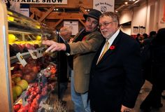 New Minister of Agriculture, Food and Rural Affairs, Minister Ted McMeekin discusses Ontario's apple bounty with Brian Gilroy, Chair of the Ontario Apple Growers, at the Royal Agricultural Winter Fair.