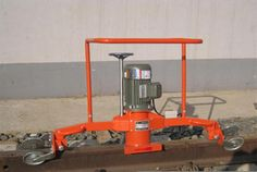 NGM-4.4 Internal Combustion Rails Grinder Keyword:gasoline engine rails grinding machine; rails grinding machine; NGM-4.4 internal combustion rails grinder   Application:  chincoal10 Small-sized special tool for polishing welded joint, surface damage and side trimming.  Feature: 1.Gasoline driven, strong adaptability to an open working environment. 2.Compact structure, light weight, convenient station conversion. 3.Partial grinding operation of railway rail conveniently and swiftly.  Main…