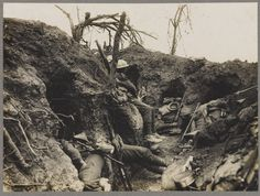 WW1, Battle of the Somme. Soldiers of the Border Regiment resting in a front line trench, Thiepval Wood, August 1916 nam.ac.uk