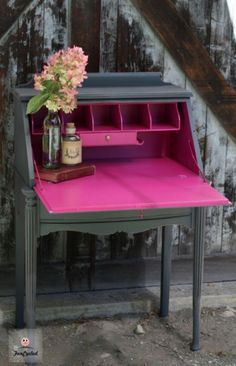Inside of secretary painted in the color crushed berries from Benjamin Moore.