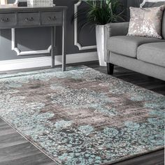 Brimming with the beauty of a bohemian, this exquisite area rug is sure to make any abode a little more airy. Start by rolling it out between a pair of crisp white loveseats for a pop of contrast in the den, then add eye-catching appeal and comfort by piling in plush patterned pillows and a few woven pouf ottomans scattered around the room. Machine woven of 100% polyester, it offers a low cut pile design with a distressed scrolling Persian-inspired motif in hues of gray and blue so it can…