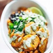 Spicy Brazilian Burrito Bowls recipe - seasoned rice and beans, garlic cilantro lime slaw, and crispy fried plantains! SO YUM // vegetarian // almost vegan. Substitute Greek yogurt for vegan yogurt. Mexican Food Recipes, Vegetarian Recipes, Cooking Recipes, Healthy Recipes, Rice Recipes, Lunch Recipes, Vegan Vegetarian, Keto Recipes, Plantain Recipes