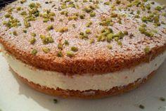 Gluten-free sponge layer-cake with whipped cream and pistachios.(Käsesahnetorte mit Pistazien)