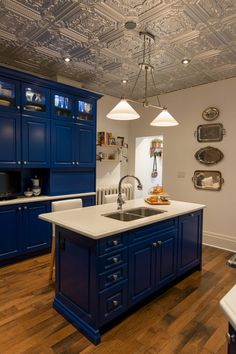 contemporary-kitchen-design-faux-tin-ceiling-tiles-blue-cabinets-hardwood-floor.jpg
