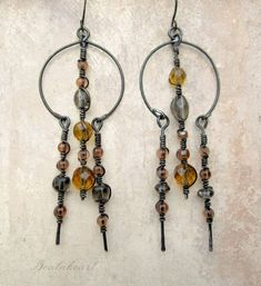 Doorway out of the dark. Springtime golden yellow dangle earrings primitive tribal modern from beatnheart on Etsy. Saved to Fancy Jewelry. Copper Jewelry, Wire Jewelry, Jewelry Crafts, Beaded Jewelry, Copper Wire, Circle Earrings, Beaded Earrings, Earrings Handmade, Hardware Jewelry
