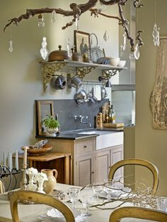 Hang crystals from a branch for a glamorous, light reflecting statement over your dining room table.