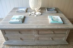 $1395 This bleached, weathered coffee table is made from solid wood and stained a beautiful soft, weathered grey this table looks stunning and is useful with 8 good sized drawers for storage.    Dimensions:  130cm wide, 100cm deep, 46cm tall