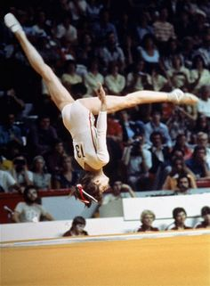 Romanian gymnast Nadia Comaneci flies through the air during gymnastics competition at the Summer Olympic games in Montreal, July 17, 1976.