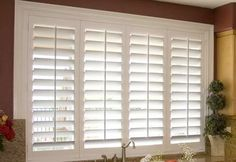 white plantation shutters installed in the Family Room opening - I like this look and it would pull the NEW WHITE KITCHEN and the FAMILY ROOM together