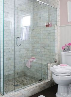 Tiled walk in shower with large bench and glass door wall