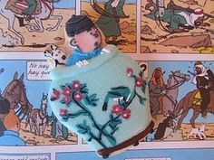 Tintin cookies - Postreadicción • Tintin iced biscuit inspired by Tintin and the Blue Lotus • Tintin gateaux Iced Biscuits, Blue Lotus, Cupcakes, Decorated Cookies, Cookie Decorating, Cookie Recipes, Disney Characters, Fictional Characters, Graphic Sweatshirt