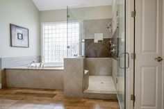 This was a beauty! We love how all the different  textures came into play. #fauxwood #bathroom #floors