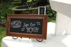 Using a bench for guests to sign #cedarwoodweddings Cottage Chic Military Wedding at Historic Cedarwood | Cedarwood Weddings