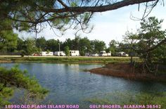 Lazy Lake RV Park, Gulf Shores, Alabama: Stocked lake, 5 minutes to beach. Full hook-ups, all spaces lake view. Cable, laundry, bathhouse, internet NO TENTS. $30/night get 7th night FREE. For more camping suggestions at the Beach, go to www.ItHappensinAlabama.com