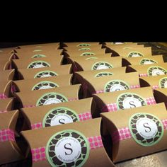 Baby shower favors : Kraft boxes fill with personalized M&M'S. Stickers, tape and boxes all from etsy.com.