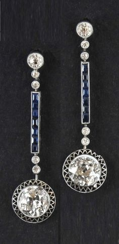 A pair of Art Deco platinum, diamond and sapphire earrings, possibly Italian, about 1925. Length 3.7cm.