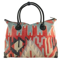 Couldn't resist this - the line is made from vintage Turkish carpets.  Kilim Boho Bag XL IV, $274, now featured on Fab.