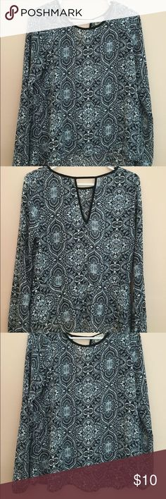 Paisley Blouse Size Medium. Lightweight. Opening in back (see photos). Elastic around both wrists. Slight hi-lo bottom hen. Tops Blouses