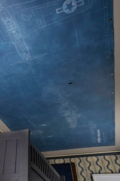 Boy's bedroom ceiling--with military airplane plans. Great idea!