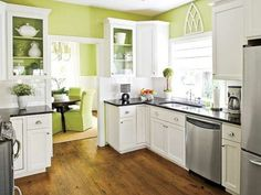 hardwood floors and green walls, black granite counters and white cabinets! love bright kitchens :)
