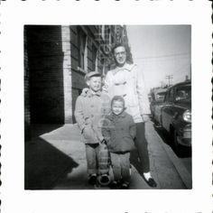 { description }  Black and white vintage 1950s photo of Mother standing with son…