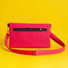 An extremely utilitarian bag that can be carried 3 ways: as a clutch, a wristlet or slung across your body!