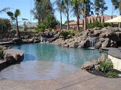 Granite Bay Cave Pool, Bordeaux Pebble sheen, Swim-In Cave, 2 Waterfalls, Swim up Bar, Spa, this pool has it all!  JimChandlerPools.com