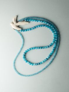 "Long necklace made from sky blue angelite beads, with a moulded bird covered in a creamy colored textile and back padded in leather. It's part of ""Dans l'air"" collection. Bird Necklace, Beaded Necklace, Blue Bird, Air, The Dreamers, Spiritual, Designers, Journey, Symbols"