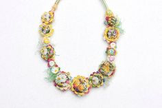 Floral textile necklace, crochet jewelry with fabric buttons, pastel, OOAK by rRradionica on Etsy https://www.etsy.com/listing/194803290/floral-textile-necklace-crochet-jewelry