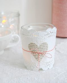 paper covered jars turned into votives. From the Style Files.