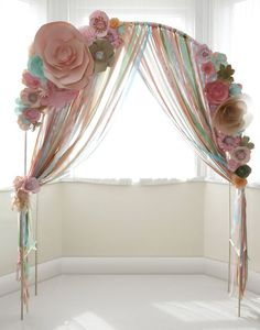 Good indication of colour scheme, peach, mint, coral, pink Paper flower wedding ceremony arch with ribons / http://www.himisspuff.com/wedding-arches-wedding-canopies/3/