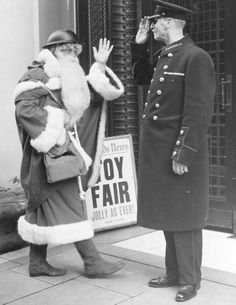 6th November 1939: Even Father Christmas follows the war time safety precautions as he arrives this year, complete with tin helmet, at London's famous Brompton road store, Harrods.