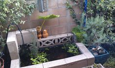 Charming patio pond built with concrete blocks.