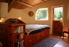 interior of a cob home- but I pinned this for the bed!
