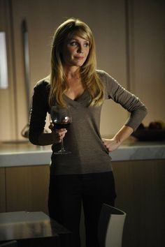 Season 2 Episode #2 - Start Me Up . . . . . . . . ~Lauren Outfit 3) Camel colored cashmere v-neck sweater and dark pants , hair down -- receiving boat insurance papers from Kate