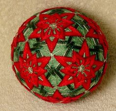 Temari means Handball. A Highly valued gift symbolizing deep friendship and loyalty. Brightly colored threads with the Recipient a Brilliant and Happy Life  Temari is an ancient form of Japanese culture and art, the gift or a Temari ball is believed to bring good fortune to the recipient. This Temari ball is a styroforam ball wrapped with yarn and thread and sewn with contemporary and traditional patterns. 3 1/4 inch diameter