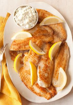 Crispy Fish with Our Favorite Sauce – Sour cream and mayonnaise combine with lemon zest to create a tasty sauce that's perfect for complementing fish coated in Parmesan cheese and skillet-cooked 'til crispy. What a savory recipe to serve up on your dinner table!