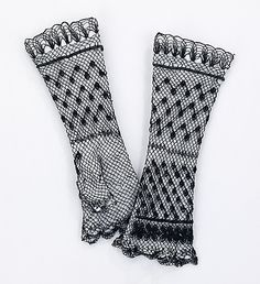 Mitts Date: 1870–79 Culture: American Medium: cotton Dimensions: 3 1/2 x 11 in. (8.9 x 27.9 cm) Credit Line: Brooklyn Museum Costume Collection at The Metropolitan Museum of Art, Gift of the Brooklyn Museum, 2009; Gift of The Jason and Peggy Westerfield Collection, 1969 Accession Number: 2009.300.2151a, b