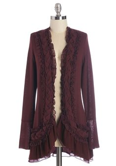 By the Flickering Firelight Cardigan in Merlot. Nothing says 'perfect night in' to you quite like snuggling up in front of your fireplace with a book in this long-sleeved maroon cardigan! #red #modcloth