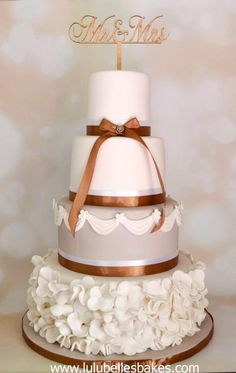 Simple, elegant cream and beige wedding cake with swags made using Marvelous Molds and ruffles from a simple flower cutter. Wedding Cake Prices, Unique Wedding Cakes, Wedding Cake Designs, Wedding Cupcakes, Crazy Cakes, Fancy Cakes, Ruffle Cake, Ruffles, Cake Pricing