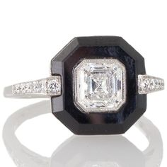 Art Deco style Asscher cut diamond & onyx ring. View our collection of antique, Art Deco, and modern jewellery at www.rutherford.com.au