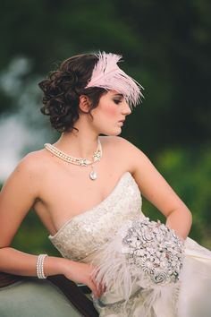 Dress, necklace,Sparkling Brooch bouquet.....love everything about this!  Well maybe not the feather