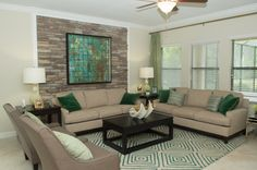 Beautiful stone wall in our Eastham living room!