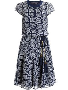 Monsoon navy dress with white pattern and waist tie with tassels.  Very cute look.