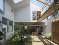 A simple gabled form glad in corrugated metal encloses a series of rooms arranged around an internal courtyard at this house in Kobe by Tato Architects. Architect House, Architect Design, Interior Garden, Interior And Exterior, Wooden Wardrobe, Internal Courtyard, Timber House, Courtyard House, Ground Floor