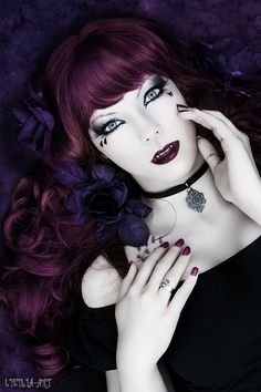 Vampire Goth. She bites! Haha well I don't know about all that but the hair is pretty purple dark